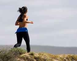 Woman jogging outside - Healthy Living blog post