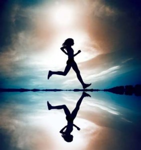Woman jogging on beach - Did you know your body has the ability to produce its own natural pain killers blog post