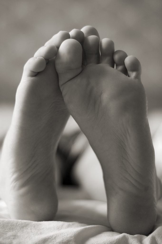 Grayscale image of feet - The benefits of orthotics blog post