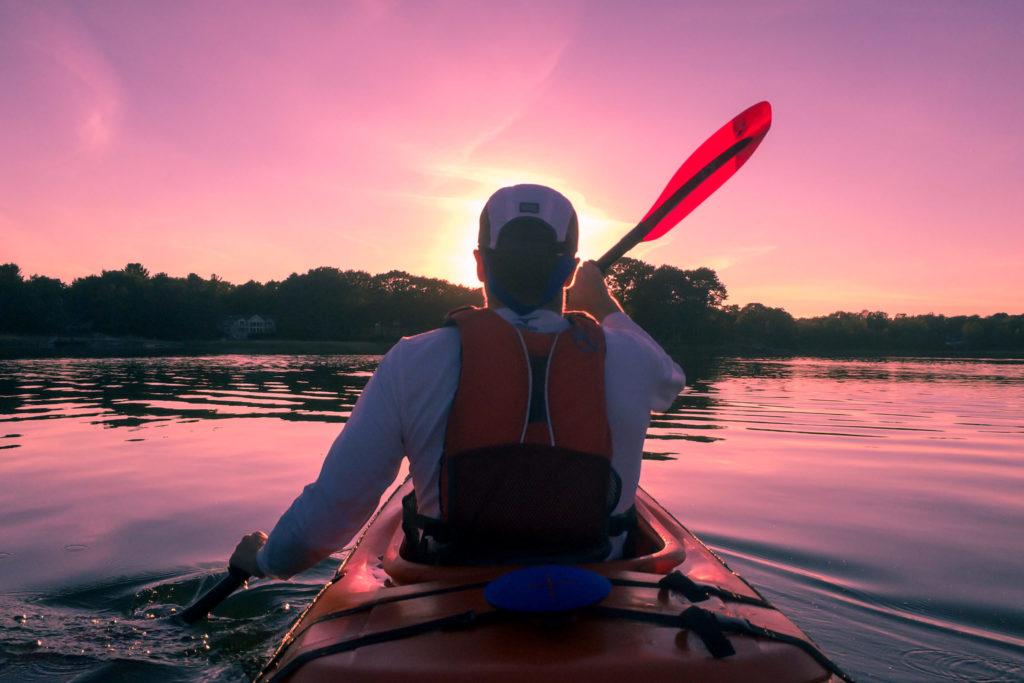 Man canoeing on water - Brain Training blog post