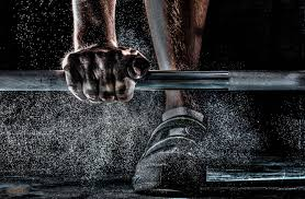 Person with hand on weight bar - The Benefits of Personalizing Your Gym Program blog post