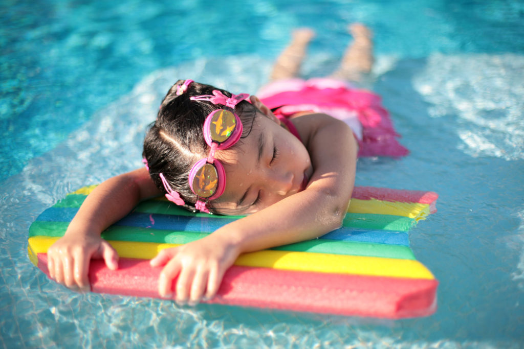 Child laying on floating device in water - Allergic to exercise blog post