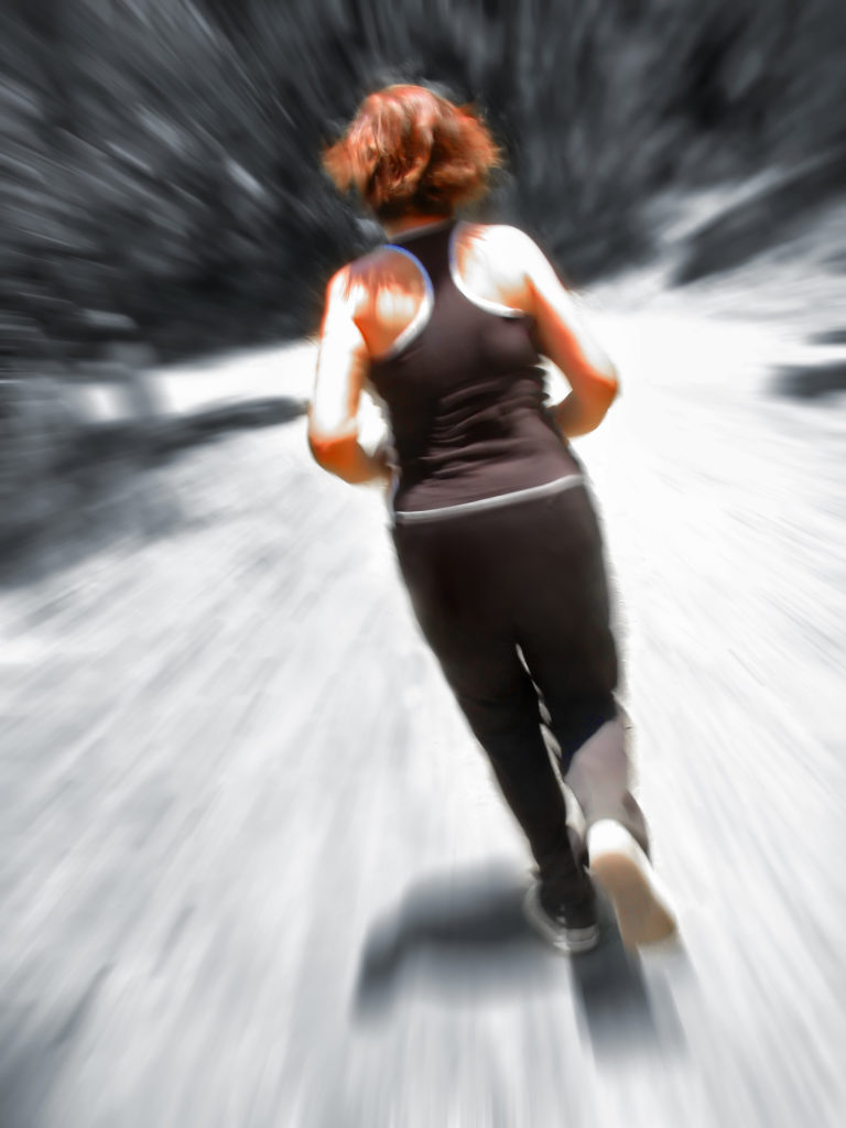 Woman jogging outside - Ever wonder why, sometimes, you don't look forward to exercising blog post