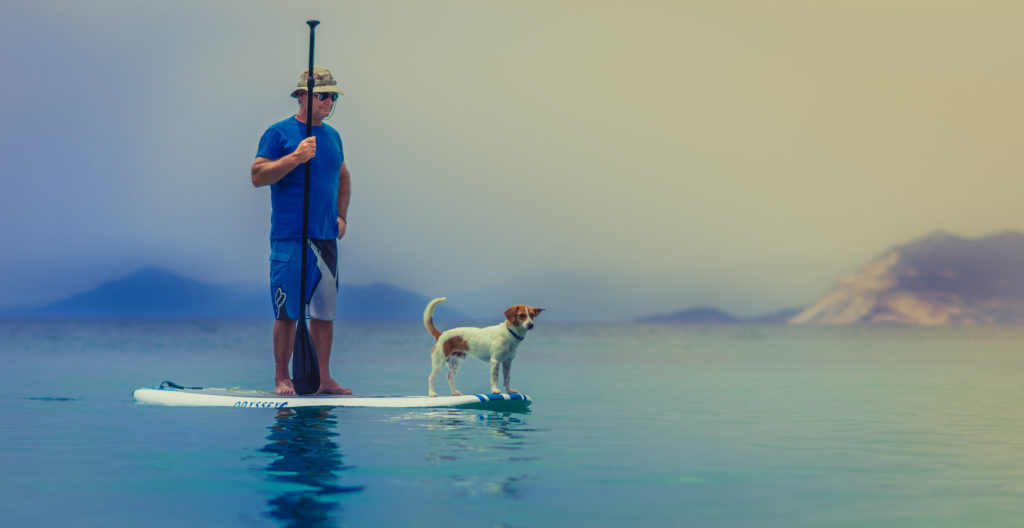Older man with dog on raft - Aging and Body Weight blog post