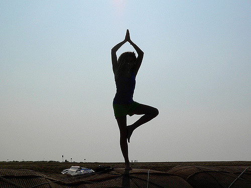 Woman in yoga pose outside - Aging and your posture blog post