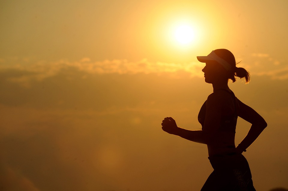 Woman jogging outside - Your workouts improve your brainpower blog post