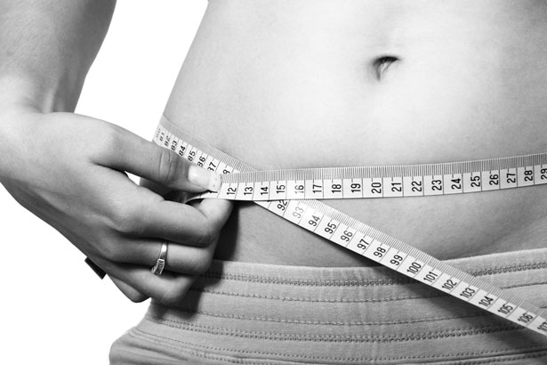 Woman using measuring tape to measure waist - Want to lose weight…here's one way to do it blog post