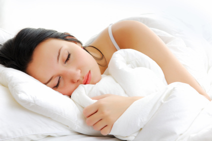 Woman sleeping in bed - Sleep is vital…so, here's some tips to improve the quality of your sleep blog post