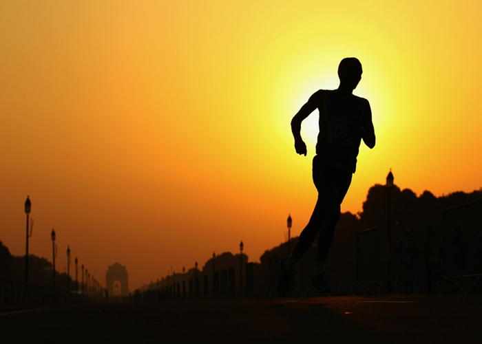 Silhouette of man jogging outside - Exercise for your body and mind blog post