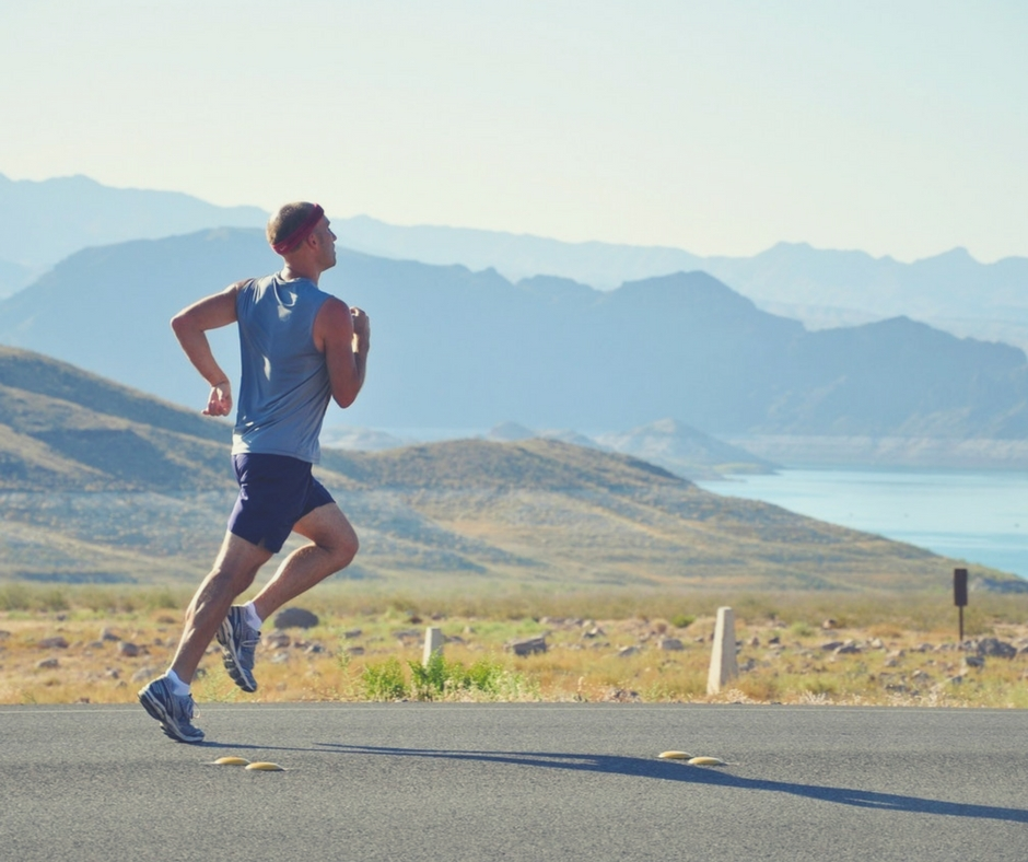 Man jogging on road with hills in background - 5 Ways to Rev Up Your Energy! blog post