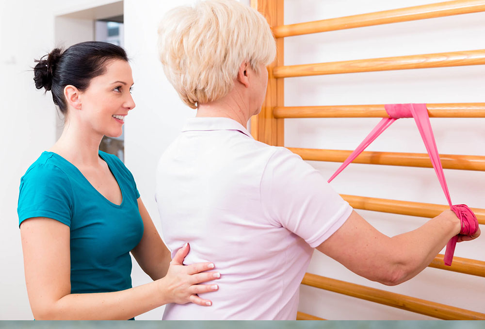 Physiotherapist helping woman in posture program