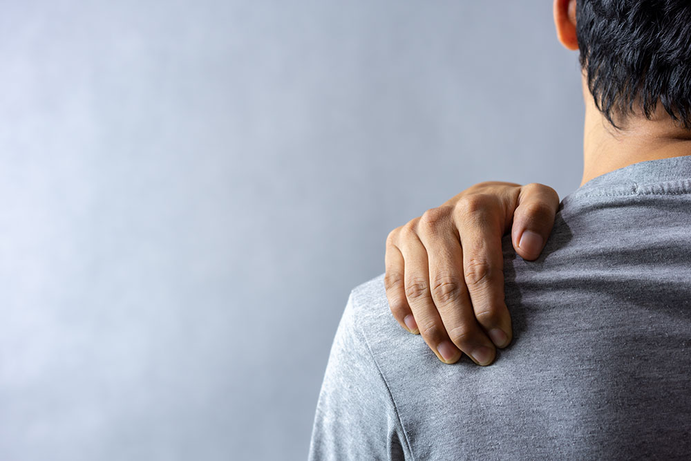 Man experiencing back or shoulder pain