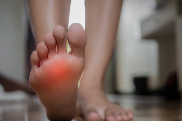 Person with bare feet - pain on bottom of foot - Is Heel Pain Hindering Your Mobility? blog post
