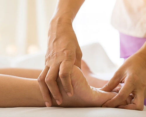 Physiotherapist with patient with foot issues